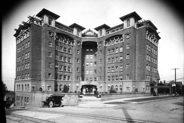 """""""By 1912, a number of hotels had been built just outside Seattle's downtown area for people traveling on business or pleasure. The Hotel Sorrento, which advertised itself as """"A hotel in the heart of things"""" opened on First Hill in 1908. It had Seattle's first rooftop restaurant, a roof garden, and scenic views of the city, the bay, and the mountains. This photo shows the Hotel Sorrento in about 1912. The hotel still stands on the corner of Madison Street and Terry Avenue."""" -MOHAI. Photo courtesy MOHAI, PEMCO Webster and Stevens Collection, image number 1983.10.9468.1."""