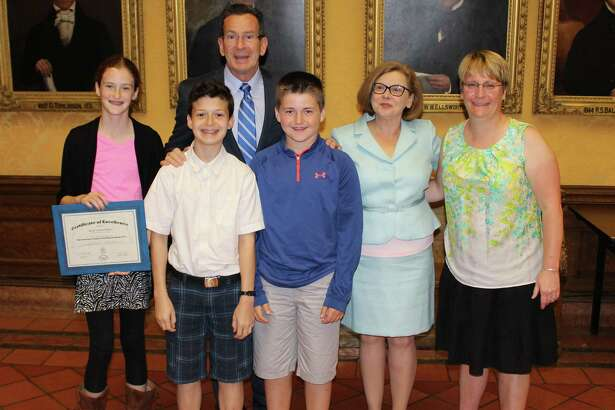 Kent Center School is celebrating 97 percent participation in the Governor'ss 2016 Summer Reading Challenge. Above, students, from left to right, Leah Darby, Aiden Vega and William Starr, join Governor Dannel P. Malloy, Dianna R. Wentzell, commissioner of education, second from right, and Kent Center School librarian Betsy Morrow, during a ceremony honoring students for participation in the 2015 Summer Reading Challenge at the end of the last school year.