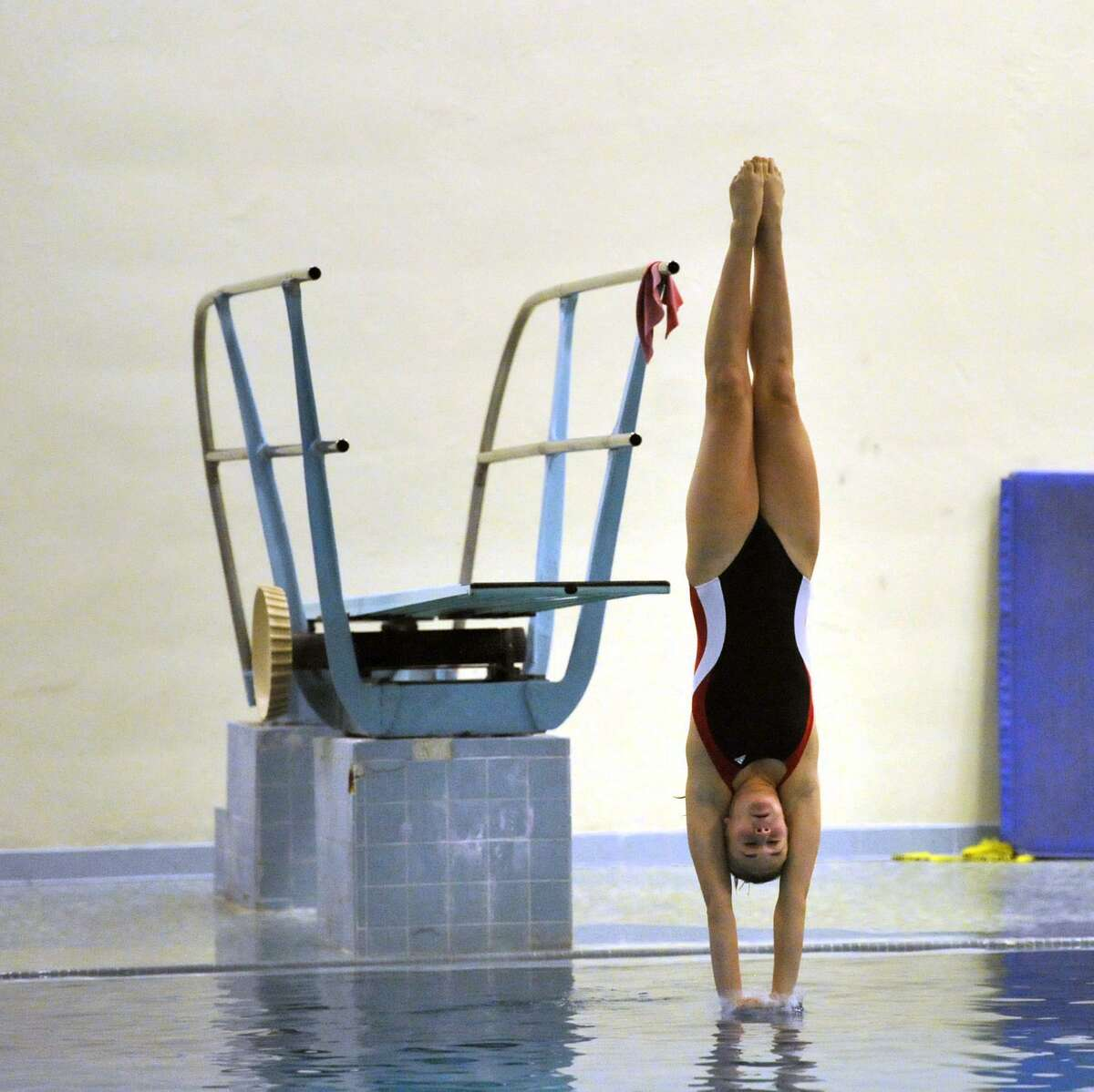 New Canaan's Kate Kushner makes a dive during the FCIAC girls diving championships at Westhill High School in Stamford.