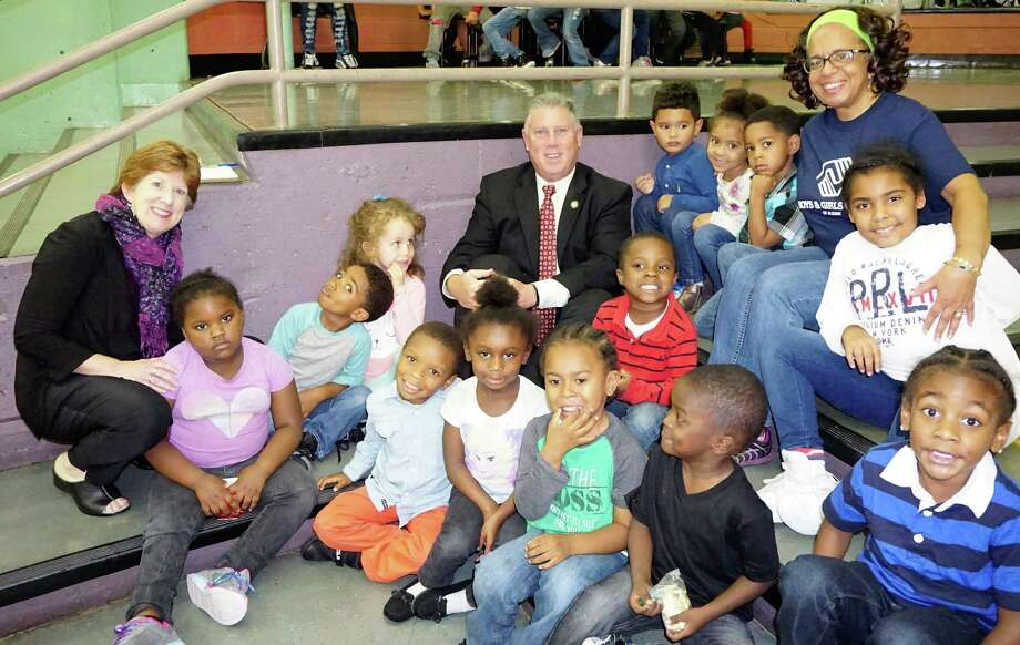 """Albany Mayor Kathy Sheehan and Assemblyman John McDonald celebrate """"Lights On Afterschool"""" with the pre-school class of the Boys & Girls club of Albany. The event, which took place Oct. 20 at the Arbor Hill Elementary School, was one of thousands happening across the U.S. as part of a national effort to bring awareness to the positive impact afterschool programs have on children and the need to expand afterschool opportunities so that every child who needs a program has access to one. For every $1 investment in afterschool programs, New York state taxpayers save $3 in reduced costs for student remediation and grade repetition. (Corning Place Communications)"""