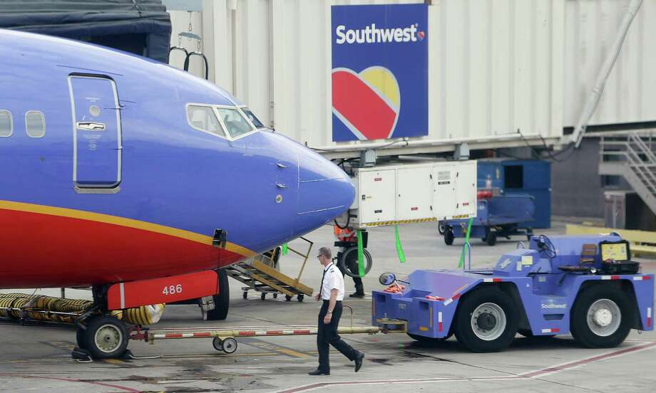 In this Monday, May 9, 2016, photo, a Southwest Airlines pilot performs a preflight check on an aircraft at Hartsfield–Jackson Atlanta International Airport, in Atlanta. Southwest Airlines reports financial results Wednesday, Oct. 26, 2016. (AP Photo/Mike Stewart) ORG XMIT: GAMS302 Photo: Mike Stewart / Copyright 2016 The Associated Press. All rights reserved. This m