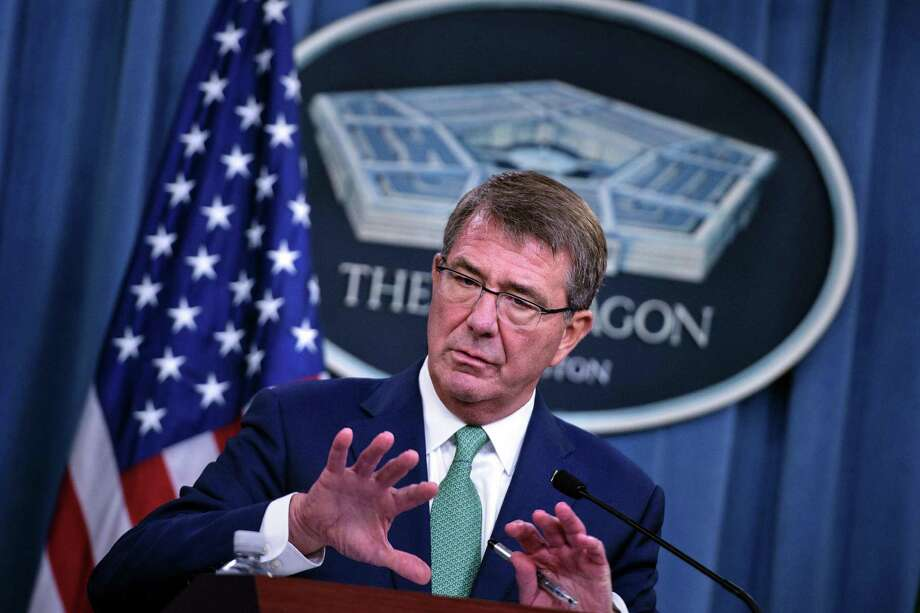 (FILES) This file photo taken on August 29, 2016 shows US Secretary of Defense Ashton Carter  during a press conference with India's Minister of Defence Manohar Parrikar at the Pentagon in Washington, DC. The Pentagon is halting efforts to claw back recruitment bonuses paid out a decade ago to enlist troops to fight in Iraq and Afghanistan, US Defense Secretary Ashton Carter announced October 26, 2016, responding to public outrage. Nearly 10,000 California National Guard members were being ordered to pay back at least $15,000 each in bonuses used as inducements during recruitment drives to overcome a troop shortage.  / AFP PHOTO / Brendan SmialowskiBRENDAN SMIALOWSKI/AFP/Getty Images ORG XMIT: Pentagon Photo: BRENDAN SMIALOWSKI / AFP or licensors