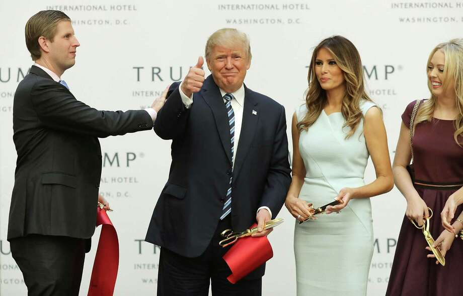 WASHINGTON, DC - OCTOBER 26:  Republican presidential nominee Donald Trump gives a thumbs up after cutting the ribbon at the new Trump International Hotel with his son Eric Trump (L), wife Melania Trump and daughter Tiffany Trump (R) October 26, 2016 in Washington, DC. The hotel, built inside the historic Old Post Office, has 263 luxry rooms, including the 6,300-square-foot 'Trump Townhouse' at $100,000 a night, with a five-night minimum. The Trump Organization was granted a 60-year lease to the historic building by the federal government before the billionaire New York real estate mogul announced his intent to run for president.  (Photo by Chip Somodevilla/Getty Images) *** BESTPIX *** ORG XMIT: 678240137 Photo: Chip Somodevilla / 2016 Getty Images