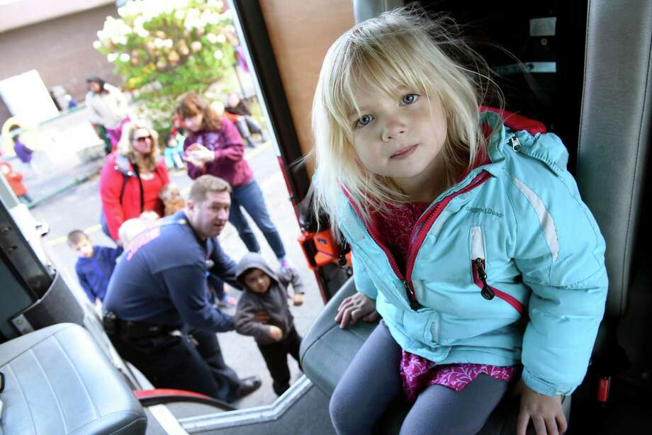 Preschooler Emilie Lloyd, 3, takes her turn sitting in the fire truck during a fire education event with Niskayuna Fire District 1 on Wednesday, Oct. 26, 2016, at Schenectady JCC in Niskayuna, N.Y. (Cindy Schultz / Times Union) Photo: Cindy Schultz / Albany Times Union