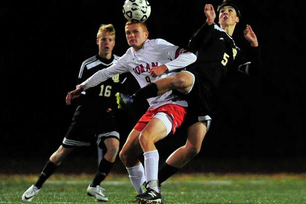 Foran's James Cronin, left, and Jonathan Law's Dennis Sweeney converge on the ball during boys soccer action in Milford, Conn., on Wedneday Oct. 26, 2016.