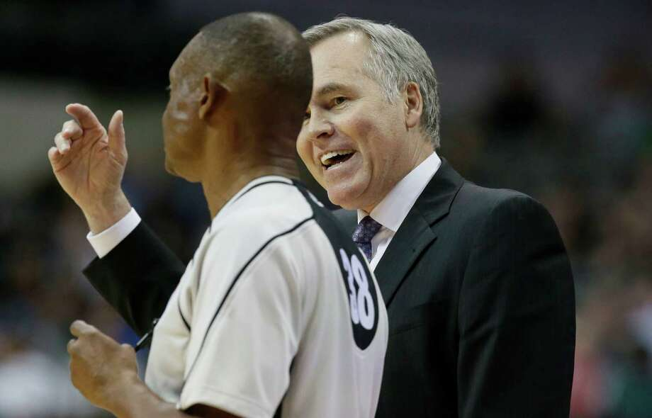 Houston Rockets coach Mike D'Antoni, right, disputes a call to referee Michael Smith during the second half of an NBA preseason basketball game against the Minnesota Timberwolves on Wednesday, Oct. 19, 2016, in Dallas  The Rockets won 109-91. (AP Photo/LM Otero) Photo: LM Otero, STF / Copyright 2016 The Associated Press. All rights reserved.