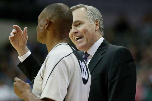 Houston Rockets coach Mike D'Antoni, right, disputes a call to referee Michael Smith during the second half of an NBA preseason basketball game against the Minnesota Timberwolves on Wednesday, Oct. 19, 2016, in Dallas  The Rockets won 109-91. (AP Photo/LM Otero)