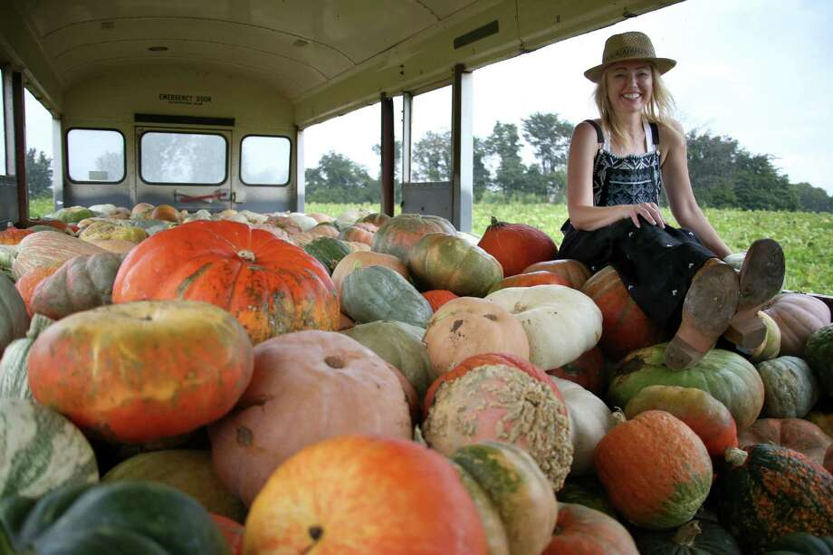 Sarah Frey, owner of Frey Farms, sits atop a mound of her pumpkins at her farm in Poseyville, Ind. Frey has made a fortune farming all kinds of pumpkins. Photo: AARON BORTON, STR / NYTNS