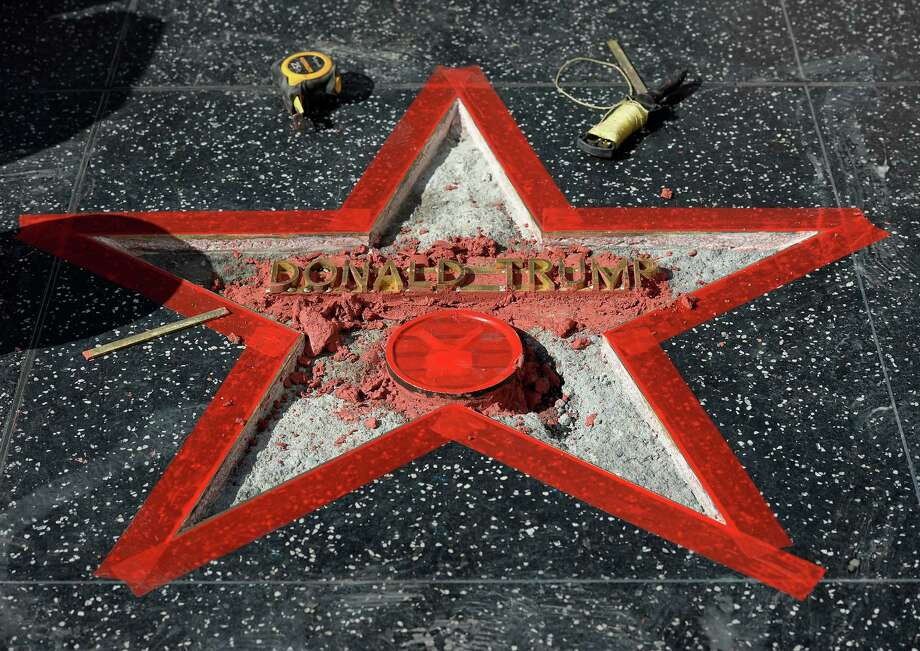 LOS ANGELES, CA - OCTOBER 26: Donald Trump's 'Hollywood Walk Of Fame Star is repaired after it was vandalized October 26, 2016 in Hollywood, California. (Photo by Kevork Djansezian/Getty Images) ORG XMIT: 678575291 Photo: Kevork Djansezian / 2016 Getty Images