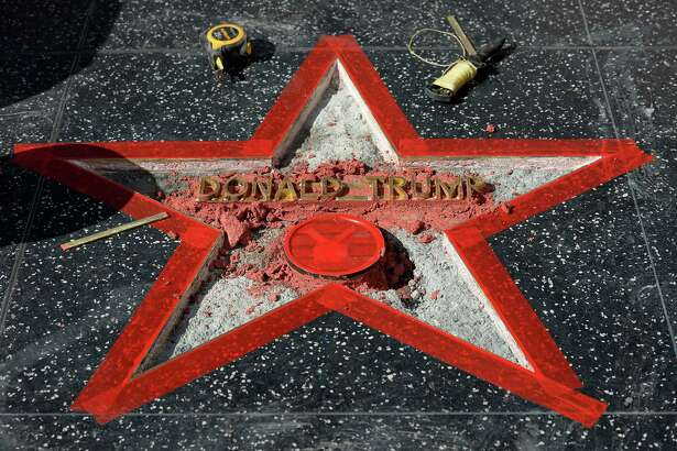 LOS ANGELES, CA - OCTOBER 26: Donald Trump's 'Hollywood Walk Of Fame Star is repaired after it was vandalized October 26, 2016 in Hollywood, California. (Photo by Kevork Djansezian/Getty Images) ORG XMIT: 678575291