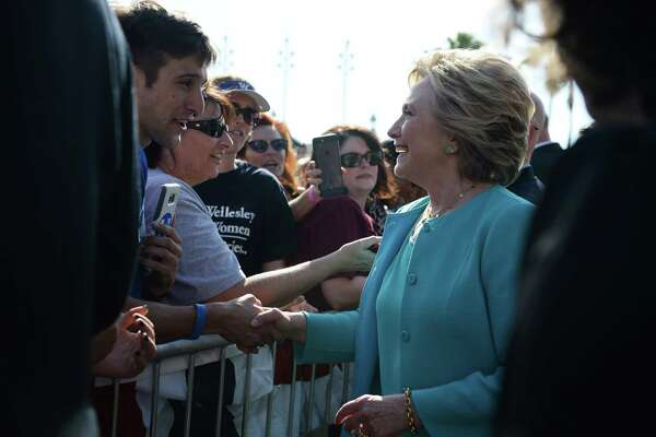 Democratic presidential nominee Hillary Clinton greets supporters at a rally at Curtis Hixon Waterfront Park in Tampa, Florida, October 26, 2016. / AFP PHOTO / Robyn BECKROBYN BECK/AFP/Getty Images