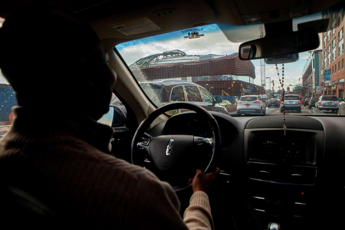 FILE -- An Uber driver passes the Barclay's Center as he drives toward the Brooklyn Bridge, in New York, Jan. 30, 2015. New research shows that the rise in independent contractor and on-call jobs -- sometimes referred to as on-demand and gig economy work -- between 2005 and 2015 accounts for the entire net gain in jobs in that span. (Sam Hodgson/The New York Times) ORG XMIT: XNYT183