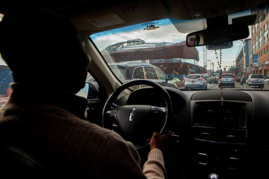 FILE -- An Uber driver passes the Barclay's Center as he drives toward the Brooklyn Bridge, in New York, Jan. 30, 2015. New research shows that the rise in independent contractor and on-call jobs -- sometimes referred to as on-demand and gig economy work -- between 2005 and 2015 accounts for the entire net gain in jobs in that span. (Sam Hodgson/The New York Times) ORG XMIT: XNYT183 Photo: SAM HODGSON / NYTNS