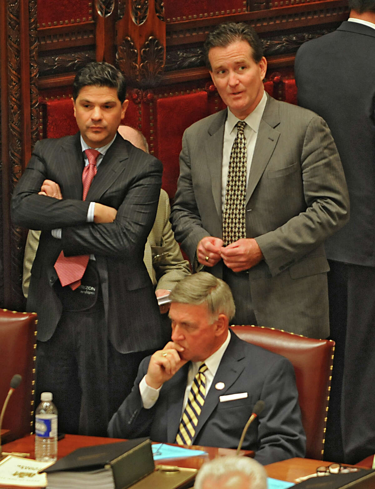 Senators George Amedore, left, John Flanagan and Rich Funke, sitting, are seen as members of the New York State Senate gather for session in the senate chamber at the Capitol on Monday, May 4, 2015 in Albany, N.Y. (Lori Van Buren / Times Union)