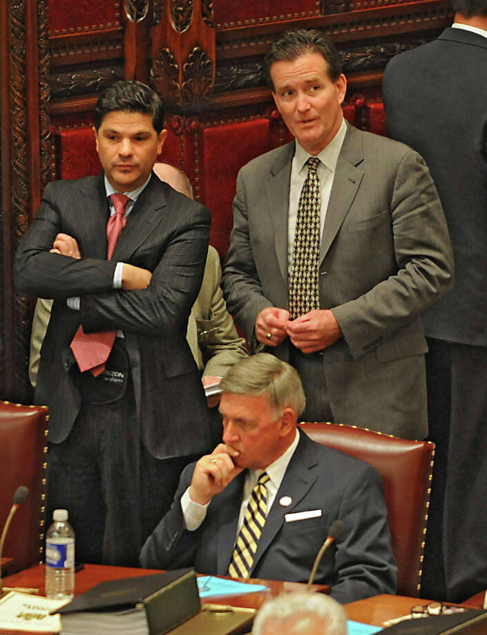 Senators George Amedore, left, John Flanagan and Rich Funke, sitting, are seen as members of the New York State Senate gather for session in the senate chamber at the Capitol on Monday, May 4, 2015 in Albany, N.Y.  (Lori Van Buren / Times Union) Photo: Lori Van Buren