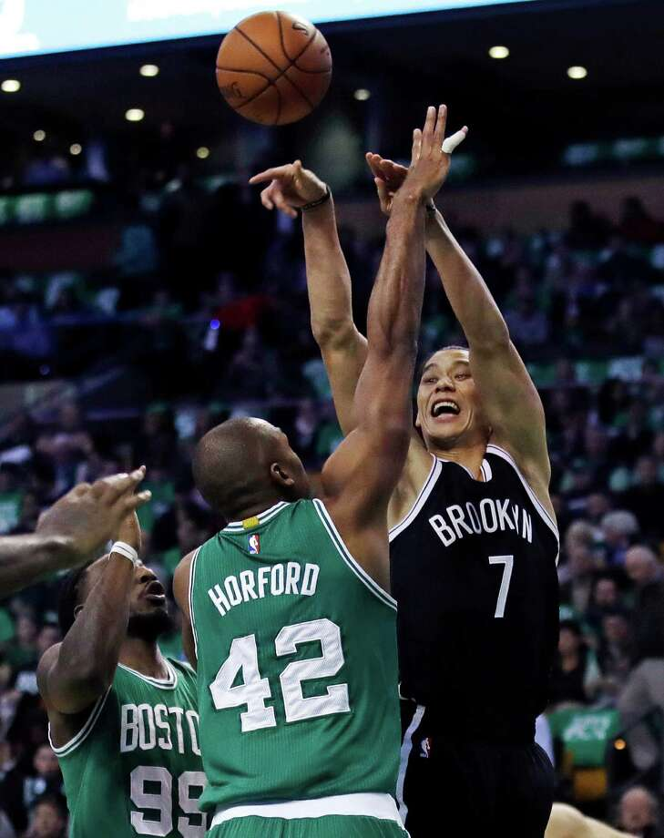 Brooklyn Nets guard Jeremy Lin (7) shoots over Boston Celtics center Al Horford (42) during the first quarter of an NBA basketball game in Boston, Wednesday, Oct. 26, 2016. (AP Photo/Charles Krupa) ORG XMIT: MACK107 Photo: Charles Krupa / Copyright 2016 The Associated Press. All rights reserved.