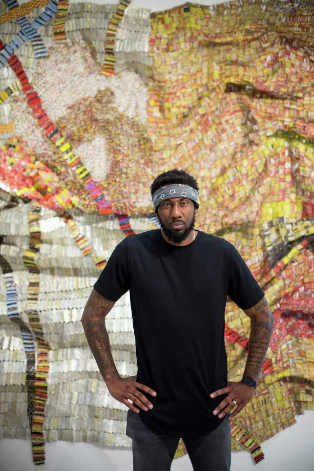 "Amar'e Stoudemire, a recently retired NBA star who continues to play in Israel for Hapoel Jerusalem, in front of a metal tapestry titled ""Delta"" (2010) by El Anatsui, at Christie's in New York, June 2, 2016. Already an avid collector, Stoudemire hopes to parlay his reputation as a cultural tastemaker into art-world clout, and recently finalized a deal with Sothebyé•s to act as a liaison to high net-worth athletes. (Michael Nagle/The New York Times) Photo: MICHAEL NAGLE, STR / NYTNS"