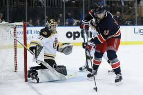 NEW YORK, NY - OCTOBER 26:  Kevin Hayes #13 of the New York Rangers scores a goal on Zane McIntyre #31 of the Boston Bruins during the second period at Madison Square Garden on October 26, 2016 in New York City.  (Photo by Michael Reaves/Getty Images) ORG XMIT: 672868551
