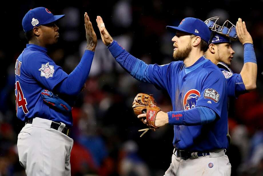 CLEVELAND, OH - OCTOBER 26:  Aroldis Chapman #54 of the Chicago Cubs celebrates with Ben Zobrist #18 after defeating the Cleveland Indians 5-1 in Game Two of the 2016 World Series at Progressive Field on October 26, 2016 in Cleveland, Ohio.  (Photo by Ezra Shaw/Getty Images) Photo: Ezra Shaw, Getty Images