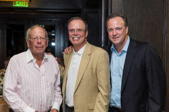 Leslie Alexander, owner of the Houston Rockets, Robert Marling; and Tad Brown, CEO of the Houston Rockets the ninth annual Connoisseurs for Charity event Sept. 25.