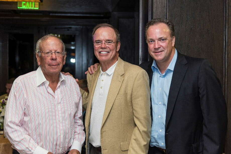 Leslie Alexander, owner of the Houston Rockets, Robert Marling; and Tad Brown, CEO of the Houston Rockets the ninth annual Connoisseurs for Charity event Sept. 25. Photo: Submitted