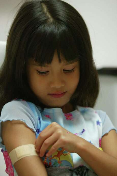 About 682,000 Texas children remain without insurance, a study says. Photo: James Nielsen, Freelance / Freelance