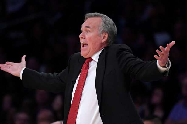 Houston Rockets head coach Mike D'Antoni yells to referees during the first half of an NBA basketball game against the Los Angeles Lakers, Wednesday, Oct. 26, 2016, in Los Angeles. (AP Photo/Mark J. Terrill)