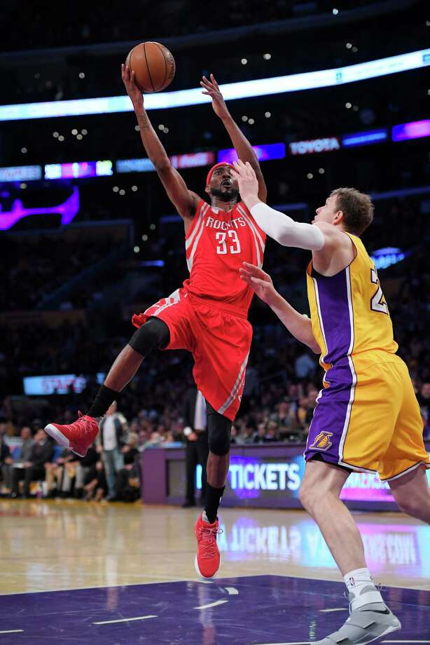 Houston Rockets forward Corey Brewer, left, shoots as Los Angeles Lakers center Timofey Mozgov, of Russia, defends during the first half of an NBA basketball game, Wednesday, Oct. 26, 2016, in Los Angeles. (AP Photo/Mark J. Terrill) Photo: Mark J. Terrill, Associated Press / Copyright 2016 The Associated Press. All rights reserved.