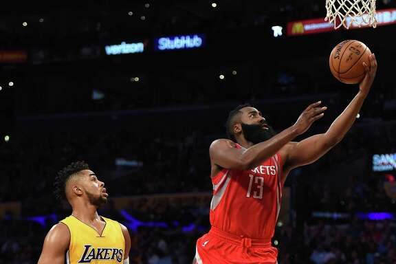 LOS ANGELES, CA - OCTOBER 26:  James Harden #13 of the Houston Rockets scores on a layup past D'Angelo Russell #1 of the Los Angeles Lakers at Staples Center on October 26, 2016 in Los Angeles, California.  NOTE TO USER: User expressly acknowledges and agrees that, by downloading and or using this photograph, User is consenting to the terms and conditions of the Getty Images License Agreement.