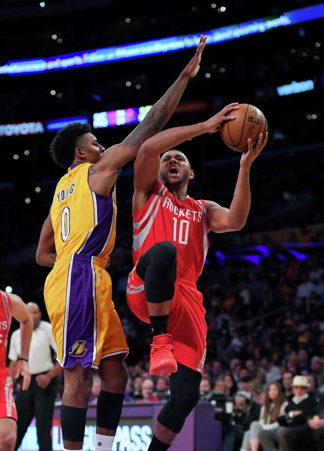 Houston Rockets guard Eric Gordon, right, goes up for a shot as Los Angeles Lakers forward Nick Young defends during the first half of an NBA basketball game, Wednesday, Oct. 26, 2016, in Los Angeles. (AP Photo/Mark J. Terrill) Photo: Mark J. Terrill, STF / AP