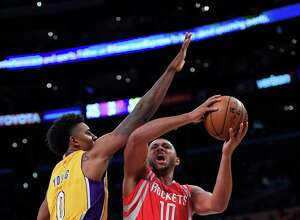 Houston Rockets guard Eric Gordon, right, goes up for a shot as Los Angeles Lakers forward Nick Young defends during the first half of an NBA basketball game, Wednesday, Oct. 26, 2016, in Los Angeles. (AP Photo/Mark J. Terrill)