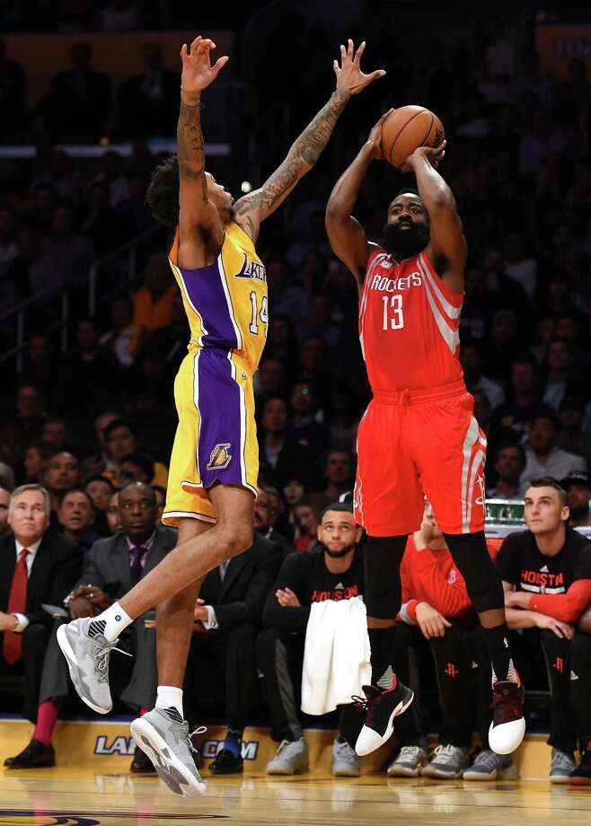 James Harden, shooting over the Lakers' Brandon Ingram, put his passing skills on display in Wednesday night's opener by racking up 17 assists. Photo: Harry How, Staff / 2016 Getty Images