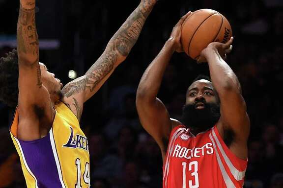 James Harden, shooting over the Lakers' Brandon Ingram, put his passing skills on display in Wednesday night's opener by racking up 17 assists.
