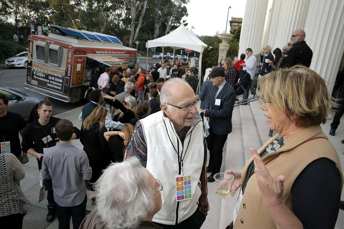 Mary Lou Jepsen, right, chats with Donald Knuth, center, and his wife, Jill Knuth, left, on the steps of the Internet Archive during a 20th anniversary celebration of the Internet Archive in San Francisco, Calif., on Wednesday, October 26, 2016.