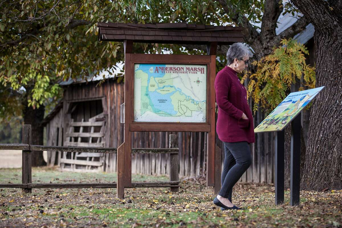 Melva Jefferson, reads up on the historic structure at the Anderson Marsh State Park in Lower Lake, California, USA 22 Oct 2016. (Peter DaSilva/Special to The Chronicle)