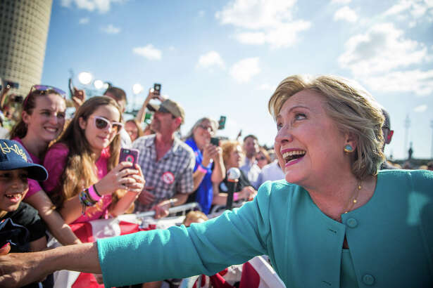 """Democratic presidential nominee Hillary Clinton greets supporters following a """"Get out the vote,"""" rally at Curtis Hixon Waterfront Park, Wednesday, Oct. 26, 2016 in downtown Tampa, Fla. (Loren Elliot/Tampa Bay Times via AP)"""