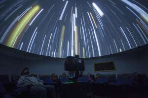 Guest watch presentation in the small planetarium  before stargazing at the Taylor Observatory in Kelseyville, California, USA 22 Oct 2016. (Peter DaSilva/Special to The Chronicle)