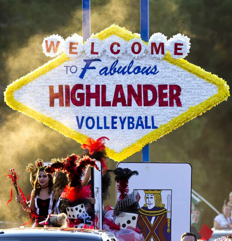 Members of The Woodlands volleyball team ride a float during The Woodlands High School's homecoming parade Wednesday, Oct. 26, 2016, in The Woodlands. Photo: Jason Fochtman/Houston Chronicle