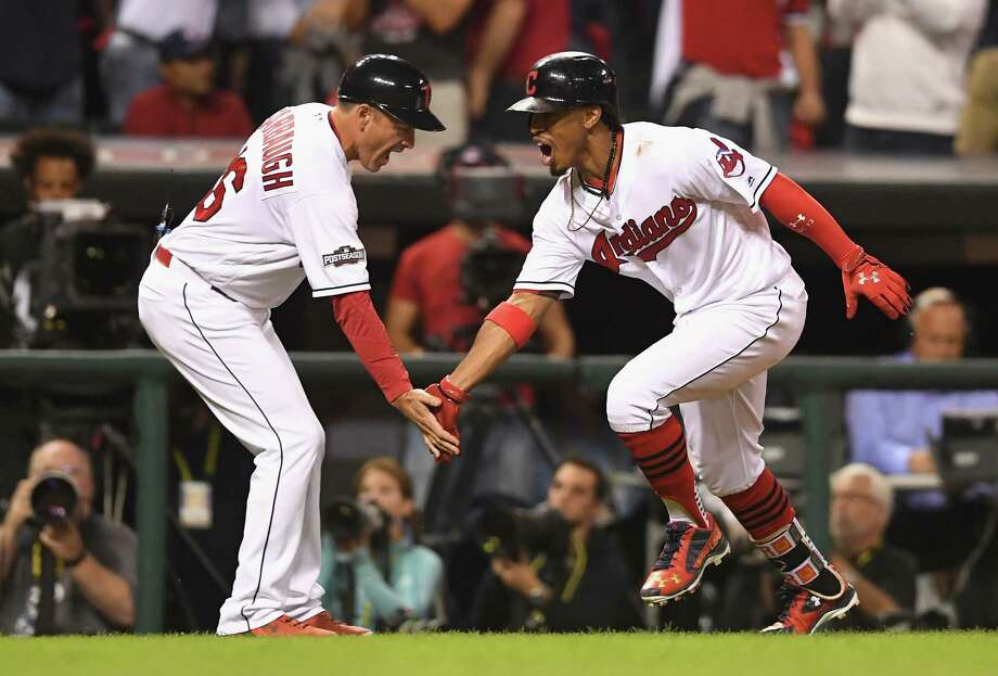 CLEVELAND, OH - OCTOBER 06:  Francisco Lindor #12 of the Cleveland Indians celebrates with third base coach Mike Sarbaugh #16 after hitting a solo home run in the third inning against the Boston Red Sox during game one of the American League Divison Series at Progressive Field on October 6, 2016 in Cleveland, Ohio.  (Photo by Jason Miller/Getty Images) Photo: Jason Miller, Stringer / 2016 Getty Images