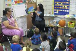 Emma Albers, a reitred Humble ISD teacher, reads to students in teacher Lauren Zindler's room as a guest reader during Red Ribbon Week at Oaks Elementary Wednesday, Oct. 26.