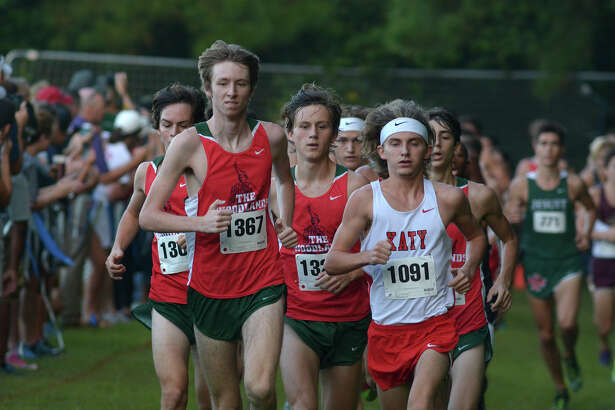 The Woodland's Noah Wells (1367) and Katy's Ryan Yerrow (1091) bookend eventual winner William Hunsdale, center, of The Woodlands, during the Varsity Boys 4800 Meter Run at the Andy Wells Invitational at Kingwood High School on Sept. 17, 2016. (Photo by Jerry Baker/Freelance)