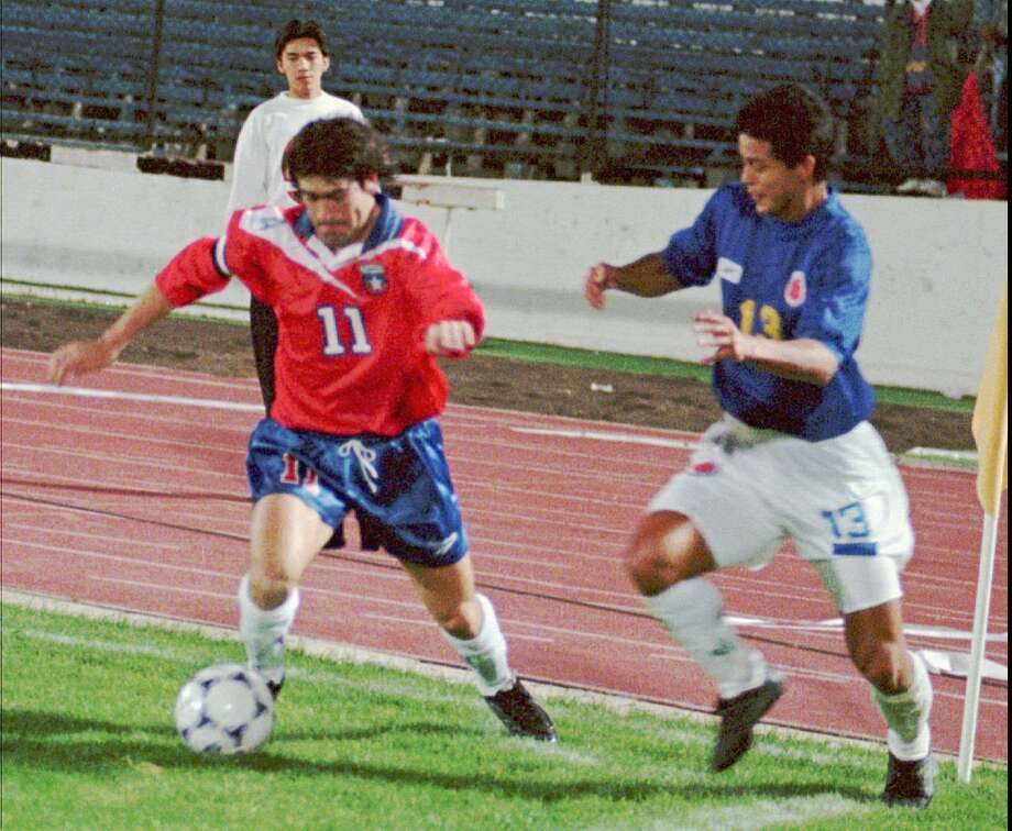 Chilean striker Marcelo Salas, left, drives the ball as Wilmer Cabrera of Colombia  moves in to defend during friendly soccer game in Santiago, Chile, Wednesday night, April 22, 1998, part of their preparation for the World Cup in France in June. The teams tied 2-2. Photo: SANTIAGO LLANQUIN, AP / AP