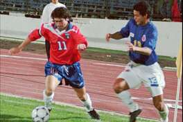 Chilean striker Marcelo Salas, left, drives the ball as Wilmer Cabrera of Colombia  moves in to defend during friendly soccer game in Santiago, Chile, Wednesday night, April 22, 1998, part of their preparation for the World Cup in France in June. The teams tied 2-2.