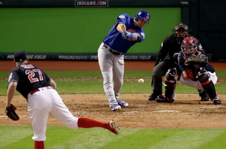 CLEVELAND, OH - OCTOBER 26:  Kyle Schwarber #12 of the Chicago Cubs hits an RBI single to score Ben Zobrist #18 (not pictured) during the fifth inning against the Cleveland Indians in Game Two of the 2016 World Series at Progressive Field on October 26, 2016 in Cleveland, Ohio. Photo: Elsa, Getty Images / 2016 Getty Images