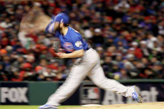 CLEVELAND, OH - OCTOBER 26:  Jake Arrieta #49 of the Chicago Cubs throws a pitch during the fifth inning against the Cleveland Indians in Game Two of the 2016 World Series at Progressive Field on October 26, 2016 in Cleveland, Ohio.