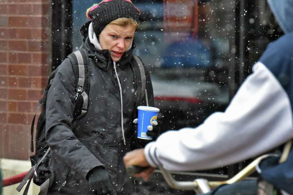 Amanda Macejka of Schenectady makes her way along State Street as snow flurries begin Thursday Oct. 27, 2016 in Schenectady, NY.  (John Carl D'Annibale / Times Union)