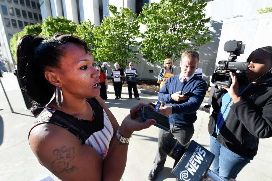 Aisha Dixon speaks to her son Marquis Dixon on the cell phone outside the Justice Building where her son's case is being argued in the Appellate Division Court Friday Sept. 16, 2016 in Albany, N.Y.  (Skip Dickstein/Times Union) Photo: SKIP DICKSTEIN / 40038058A
