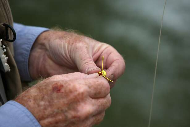 Ted Warren changes flies during the Reel Recovery Texas Fly Fishing Retreat for Men with Cancer at Joshua Creek north of Boerne on Nov. 7, 2011. The Reel Recovery mission is to help men deal with the recovery process and help in their healing through fly-fishing.