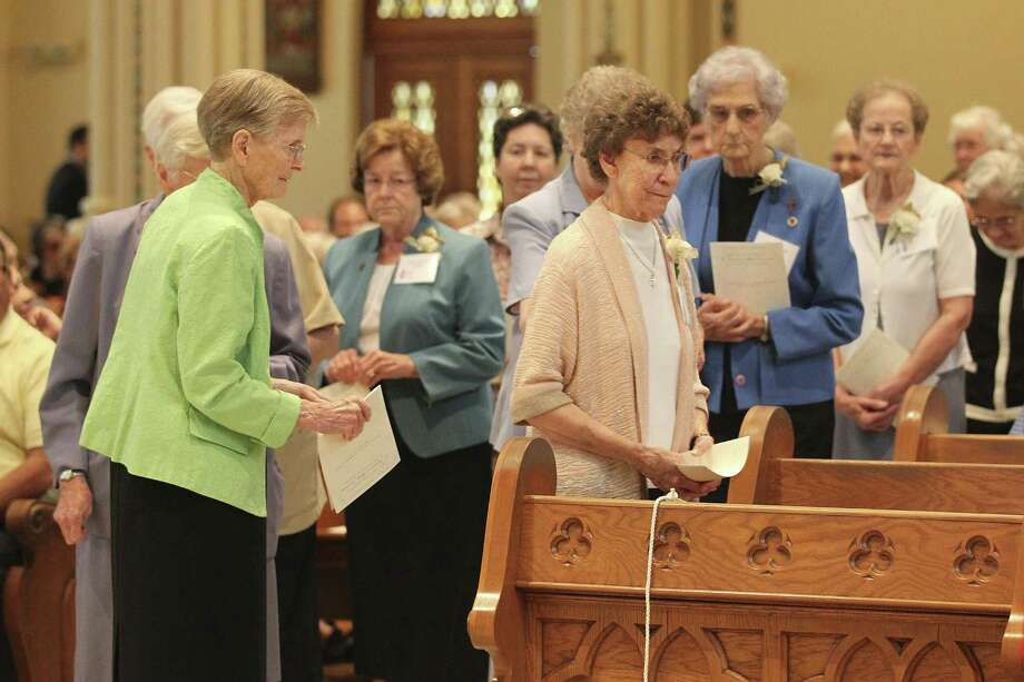 LEFT: Sisters of the Congregation of Divine Providence arrive for a mass celebrating their 150th anniversary of their presence in Texas at Our Lady of the Lake University's Sacred Heart Conventual Chapel, Sunday, Oct. 23, 2016. According to the congregation's website, Mother St. Andrew Feltin and Sister Alphonse Boegler left the Alsatian town of St. Jean de Bassel and headed to Texas in 1866. They landed in Galveston on October 25 and opened their first parochial school in 1867. The Motherhouse was established in Castroville and moved to San Antonio in 1896. Photo: Jerry Lara / San Antonio Express-News / © 2016 San Antonio Express-News