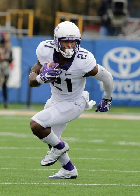 TCU running back Kyle Hicks (21) during the first half/ second half of an NCAA college football game, Saturday, Oct. 22, 2016, in Morgantown, W.Va. (AP Photo/Raymond Thompson) Photo: Ray Thompson, FRE / FR171247 AP